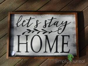 Sign Lets Stay Home